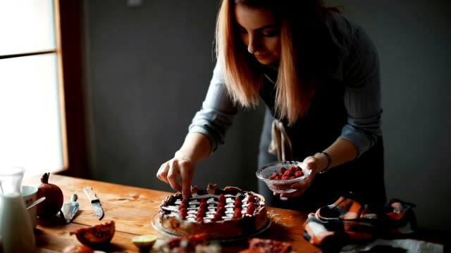 Woman making delicious cake