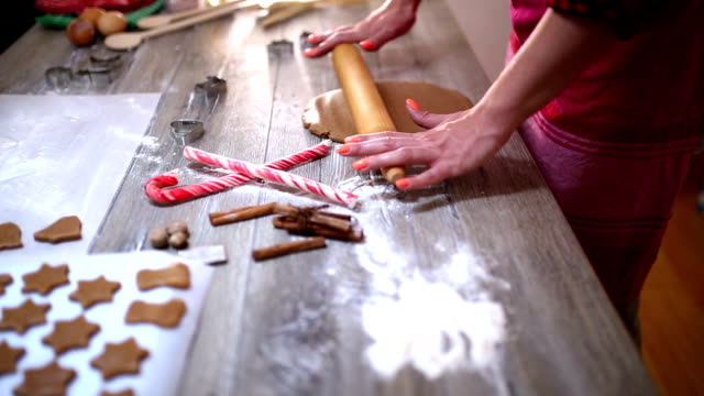 woman making gingerbread and cookies - cookie stock videos and b-roll footage