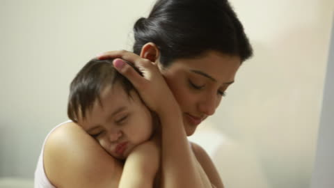 woman making her baby asleep - sleeping stock videos & royalty-free footage
