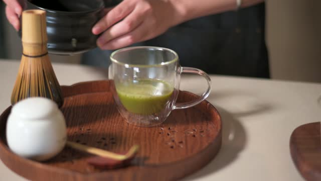 woman making matcha green tea with traditional accessories closeup - japanese food stock videos & royalty-free footage