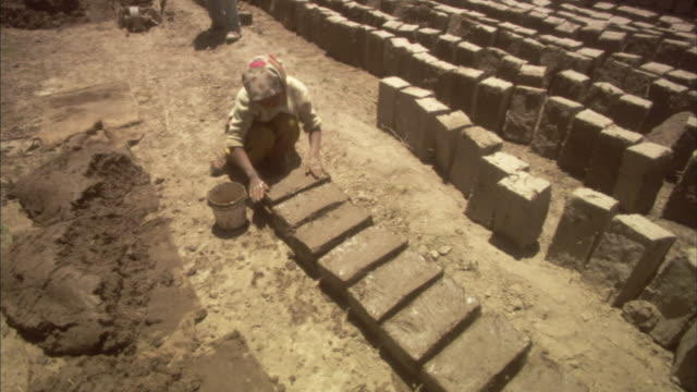 ws, ha, woman making mud bricks, ladakh, jammu and kashmir, india - mud stock videos & royalty-free footage