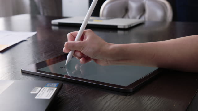 woman making notes on her digital tablet - graphics tablet stock videos & royalty-free footage