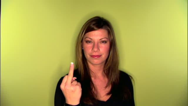 woman making obscene gesture - obscene gesture stock videos and b-roll footage