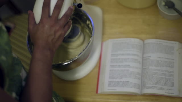 woman making pan de jamón - venezuelan traditional bread - mixing bowl stock videos and b-roll footage