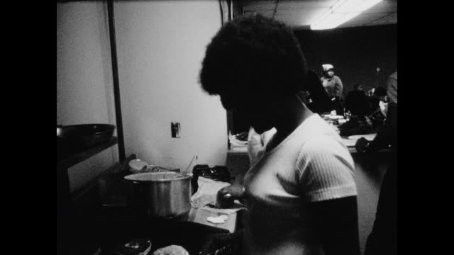 woman making pancakes on griddle in community center kitchen - black panther stock videos & royalty-free footage