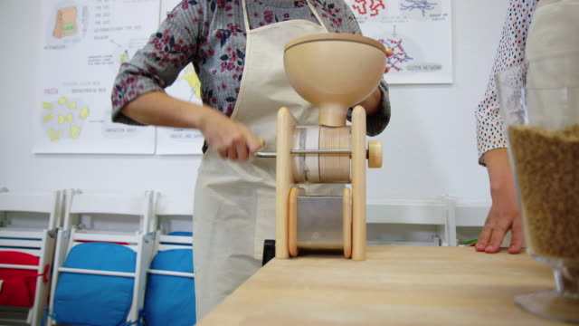 woman making pasta flour with hand mill at cooking class - flour mill stock videos & royalty-free footage