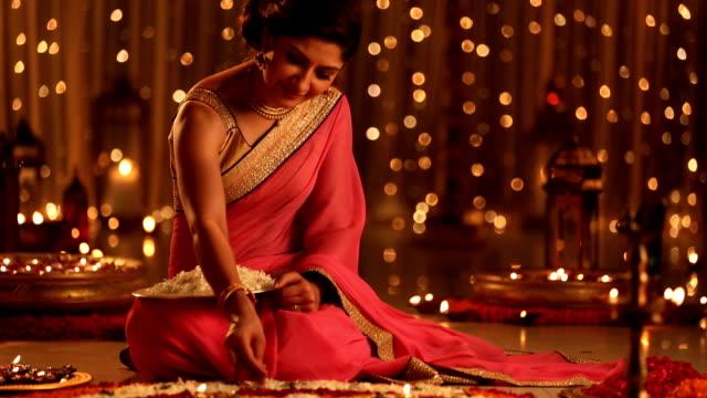 MS TU Woman making rangoli of flowers on diwali festival