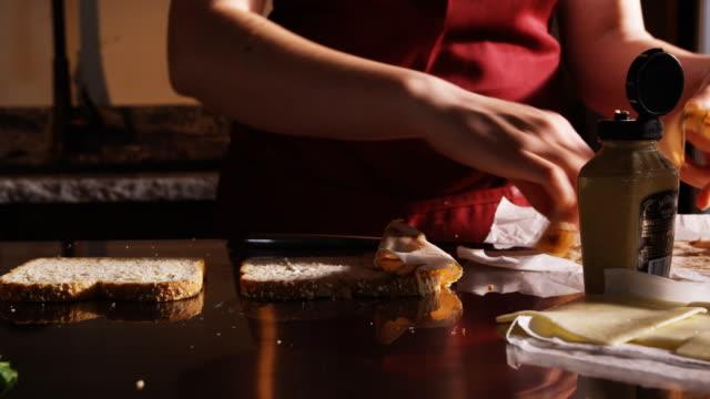 woman making sandwiches - オレム点の映像素材/bロール