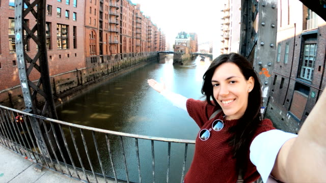 woman making selfie in hamburg old town - city break stock videos & royalty-free footage