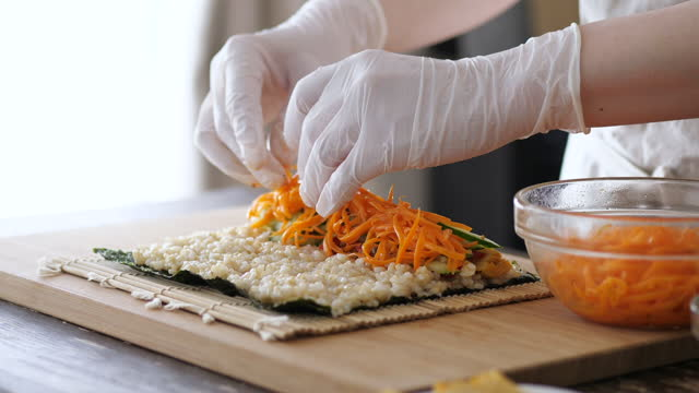 a woman making sushi rolls. - preparation stock videos & royalty-free footage