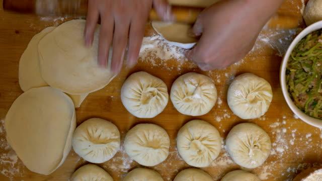 woman making traditional stuffed buns - bun stock videos & royalty-free footage