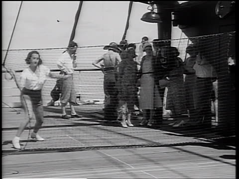 "b/w 1934 woman + man playing ""deck tennis"" with ring over net on ship deck / people watching in background - 1934 bildbanksvideor och videomaterial från bakom kulisserna"