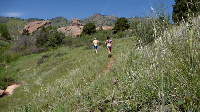 Woman man running Will Call Trail Red Rocks Park Morrison Colorado Rocky Mountains