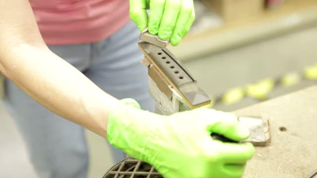 CU Woman manufacturing guitar / Nazareth, Pennsylvania, USA