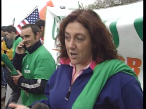 woman marching in an irish parade group mentions the thousands of undocumented irish in the us who need to get their legalization and citizenship. - human rights or social issues or immigration or employment and labor or protest or riot or lgbtqi rights or women's rights stock videos & royalty-free footage