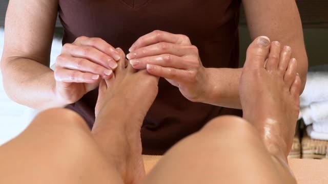 cu woman massage in wellness center / saarburg, rhineland-palatinate, germany - massage oil videos stock videos and b-roll footage