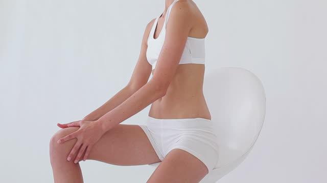 Woman massaging her thigh