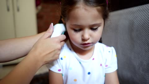 woman measuring temperature to a child - childhood stock videos & royalty-free footage