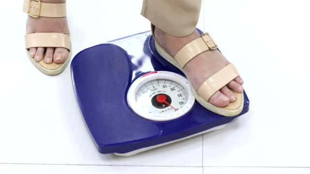 woman measuring weight, delhi, india - weight scale stock videos & royalty-free footage