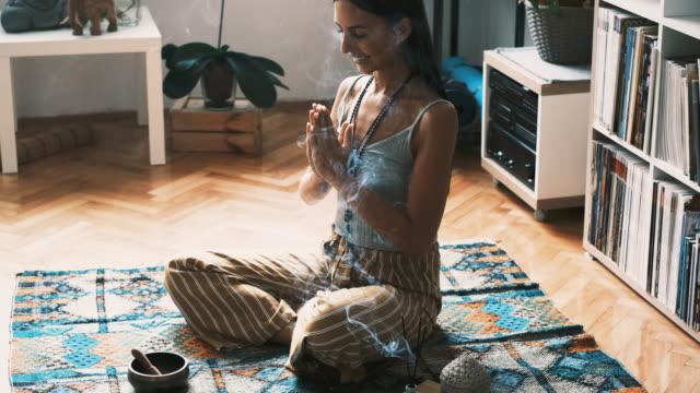 woman meditating at home - boho stock videos & royalty-free footage