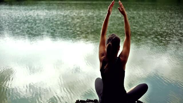 woman meditating. back view.