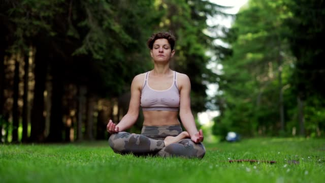 woman meditating in nature - eyes closed stock videos & royalty-free footage