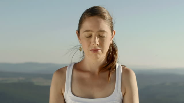 HD DOLLY: Woman Meditating On The Cliff