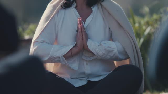 woman meditating outside - woman cross legged stock videos & royalty-free footage