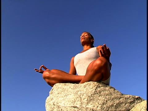 woman meditating - lotussitz stock-videos und b-roll-filmmaterial