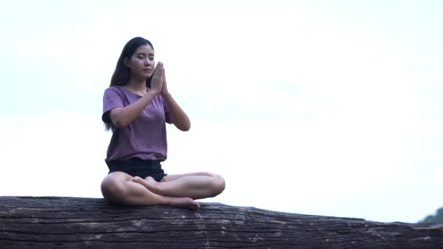 woman meditation in tropical forest ,women relax in the holiday - lotus position stock videos & royalty-free footage