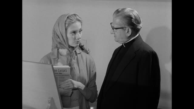 1962 a woman meets with a minister at her new job - パイプオルガン点の映像素材/bロール