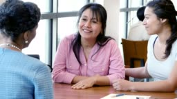Woman meets with loan officer about financing daughter's education