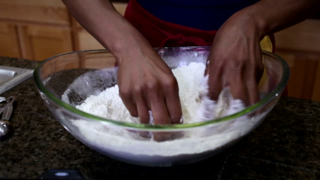 woman mixing butter and flour in bowl with hands - kneading stock videos & royalty-free footage