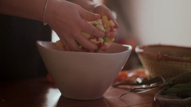 woman mixing fruit salad with hands - citrus fruit stock videos & royalty-free footage