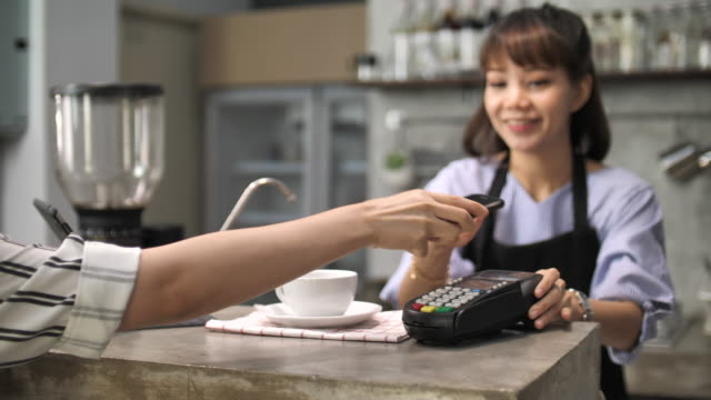 woman mobile payment by phone using contactless in coffee house - cashier stock videos & royalty-free footage