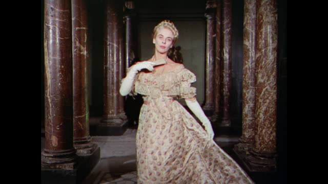 montage woman model ballroom gowns in hallway with marble pillars / uk - floor length stock videos & royalty-free footage
