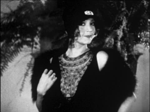 b/w 1929 woman modeling black dress + lace-trimmed hat with fur stole / newsreel - black dress stock videos & royalty-free footage