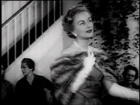 stockvideo's en b-roll-footage met 1957 woman modeling chinchilla stole in fashion show  - 1957