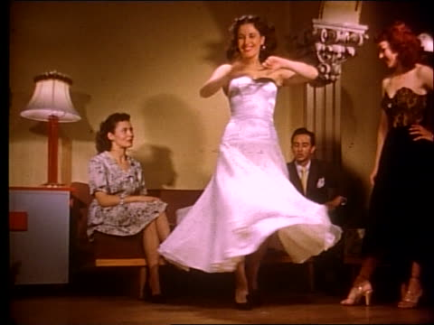 1951 woman modeling dress for 2 women and man - 1951 stock videos & royalty-free footage