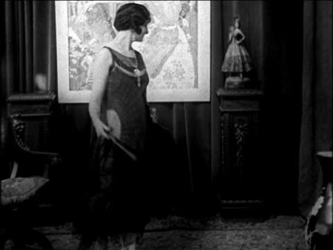 B/W 1922 woman modeling evening gown with fan / newsreel