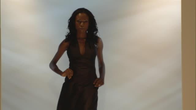 vidéos et rushes de ms woman modeling long halter dress on catwalk / london, england, uk - défilé