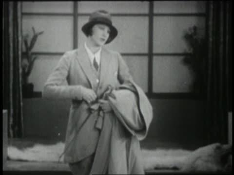 vídeos y material grabado en eventos de stock de b/w 1929 woman modeling man's suit with hat - 1920 1929