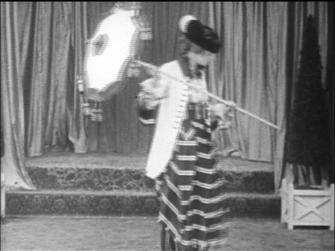 b/w 1917 woman modeling outfit with striped skirt + holding parasol - parasol stock videos & royalty-free footage