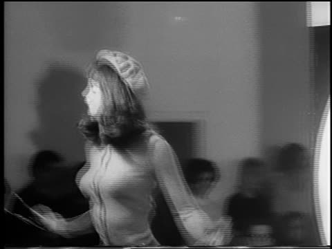 b/w 1966 woman modeling sweater beret dancing in runway show / london / newsreel - 1966 stock videos & royalty-free footage