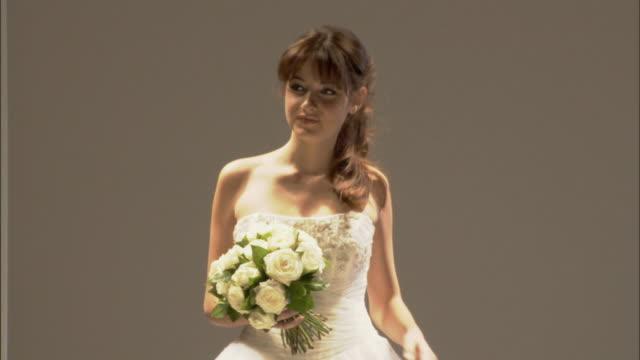 vídeos y material grabado en eventos de stock de ms woman modeling wedding dress and holding bouquet of flowers on catwalk / london, england, uk - paso largo