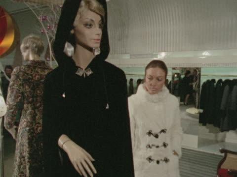 A woman models a fur maxicoat