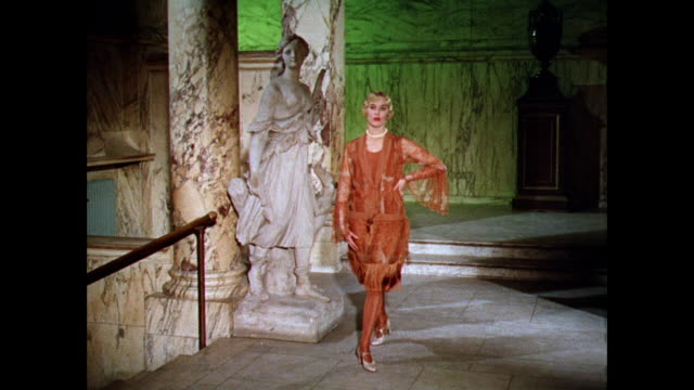 ws woman models a slim 1920s dress in a marble hallway with a sculpture / uk - arts culture and entertainment stock videos & royalty-free footage