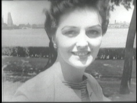 woman models a suit fashioned from khaki twill, the same material used in us army uniforms. - 1953 stock videos & royalty-free footage