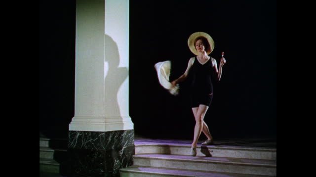 ws woman models a suitable bathing costume on stairs / uk - lollipop stock videos and b-roll footage