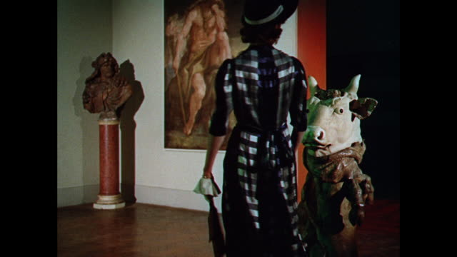 ws woman models hour glass shaped dress in front of a painting / uk - arts culture and entertainment stock videos & royalty-free footage